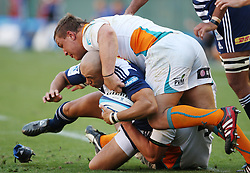 Conrad Jantjes is tac kled by Coenie Oosthuizen during the Super Rugby (Super 15) fixture between the DHL Stormers and the Cheetahs held at DHL Newlands Stadium in Cape Town, South Africa on 26 February 2011. Photo by Jacques Rossouw/SPORTZPICS