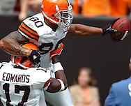 MORNING JOURNAL/DAVID RICHARD.Cleveland's Braylon Edwards celebrates with Kellen Winslow after Winslow scored the Browns first touchdown on an 18-yard pass from Charlie Frye yesterday in the third quarter.