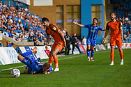 Gillingham FC midfielder Dean Parrett (8) fouled by Southend United defender Stephen Hendrie (32) during the EFL Sky Bet League 1 match between Gillingham and Southend United at the MEMS Priestfield Stadium, Gillingham, England on 13 October 2018.