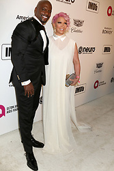 February 24, 2019 - West Hollywood, CA, USA - LOS ANGELES - FEB 24:  Terry Crews, Rebecca King-Crews at the Elton John Oscar Viewing Party on the West Hollywood Park on February 24, 2019 in West Hollywood, CA (Credit Image: © Kay Blake/ZUMA Wire)