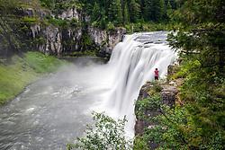 Photographer shooting Upper Mesa Falls in Island Park Idaho.