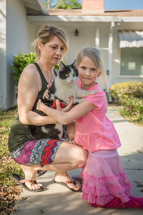 """Jonnika Benjamin with her daughter, Abby, and their cat, Lily, in front of their home in Calistoga.  """"We moved here two years ago from Santa Rosa so my husband could be closer to his plumbing job."""""""