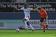Rotherham United Forward Olayinka Fredrick Oladotun Ladapo (10)  and Luton Town Defender Matty Pearson (6)  battles for possession during the EFL Sky Bet Championship match between Luton Town and Rotherham United at Kenilworth Road, Luton, England on 4 May 2021.