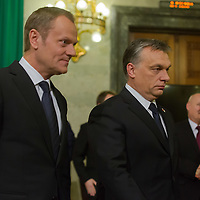 Donald Tusk (L) prime minister of Poland and his counterpart Viktor Orban (R) Prime Minister of Hungary leave after a press conference in Budapest, Hungary on January 29, 2014. ATTILA VOLGYI