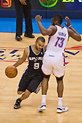 June 2, 2012; Oklahoma City, OK, USA; San Antonio Spurs guard Tony Parker (9) drives around Oklahoma City Thunder  guard James Harden (13) during a playoff game  at Chesapeake Energy Arena.  Thunder defeated the Spurs 109-103 Mandatory Credit: Beth Hall-US PRESSWIRE