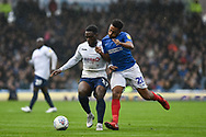 Wycombe Wanderers Forward, Fred Onyedinma (19) and Portsmouth Defender, Nathan Thompson (20) during the EFL Sky Bet League 1 match between Portsmouth and Wycombe Wanderers at Fratton Park, Portsmouth, England on 22 September 2018.