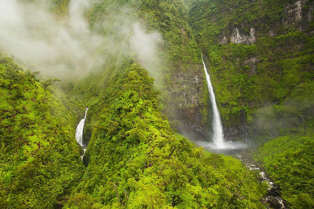 Hinalele Falls (right) and other waterfalls at the head of Wainiha Valley, Kauai, Hawaii.