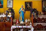 "Religious relics Inside the house of Roma resident Julius Korckovsky at the Roma part at the district ""Podsadek"". The town of Stara Lubovna has a population of 16350, of whom 2 060 (13%) are of Roma origin. The majority of Roma live in the Podsadek district, where 980 (74%) out of 1330 inhabitants are Roma."