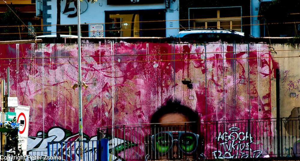 Trams station's wall decorated with graffiti in Naples, Italy