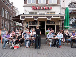 Busy cafe in city square in Den Bosch  or Hertogenbosch in The Netherlands