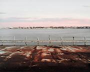 Una chiatta abbandonata utilizzata in passato per il trasporto di veicoli, attraccata ad un molo del porto di Bari. Bari, 3 novembre 2013. Christian Mantuano / OneShot