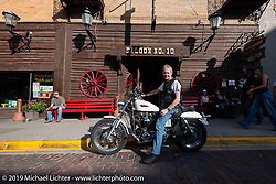 Andrew Crompton of Coventry, England on a 2002 Harley-Davidson Sportster in front of the Saloon number 10 on Main Street in Deadwood during the Sturgis Black Hills Motorcycle Rally, Friday, August 9, 2019. Photography ©2019 Michael Lichter.
