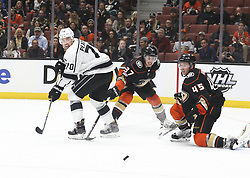 November 7, 2017 - Los Angeles, California, U.S - Los Angeles Kings forward Tanner Pearson (70) fights for the puck against Anaheim Ducks forward Nick Ritchie (37) and defenseman Sami Vatanen (45) during a 2017-2018 NHL hockey game in Anaheim, California on Nov. 7, 2017. Los Angeles Kings won 4-3 in overtime. (Credit Image: © Ringo Chiu via ZUMA Wire)