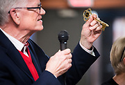 Lau Christensen holds up a golden key presented during the grand opening ceremony for Operation Fresh Start on Milwaukee Street in Madison, WI on Thursday, April 11, 2019.