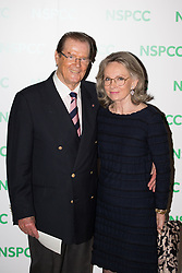 File photo dated 01/10/14 of Sir Roger Moore and his wife Kristina. Sir Roger has died in Switzerland after a short battle with cancer, his family has announced.
