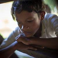 A boy sits pensively. Takéo province, Cambodia