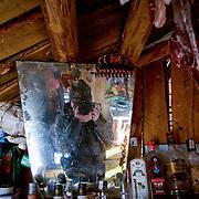 Self portrait inside simple Mongolian wood cabin (Khangil Nuur, Mongolia - Sep. 2008) (Image ID: 080915-0721071a)