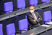 Berlin Governing Mayor Michael Mueller attends a Bundestag session dealing with the coronavirus vaccination operation in Germnay at the Bundestag in Berlin, Germany, January 13, 2021.