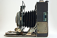 Top view of the bellows, lens and focusing rack of a 1920s Voigtlander Avus camera isolated on a white background. WATERMARKS WILL NOT APPEAR ON PRINTS OR LICENSED IMAGES.