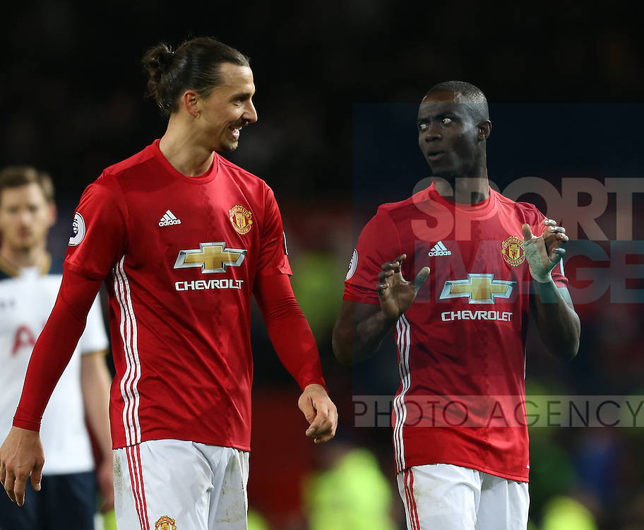 Zlatan Ibrahimovic of Manchester United laughs with Eric Bailly of Manchester United during the English Premier League match at Old Trafford Stadium, Manchester. Picture date: December 11th, 2016. Pic Simon Bellis/Sportimage