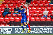 AFC Wimbledon midfielder Andy Barcham (17) goes up for the header during the EFL Sky Bet League 1 match between Walsall and AFC Wimbledon at the Banks's Stadium, Walsall, England on 14 April 2018. Picture by Simon Davies.