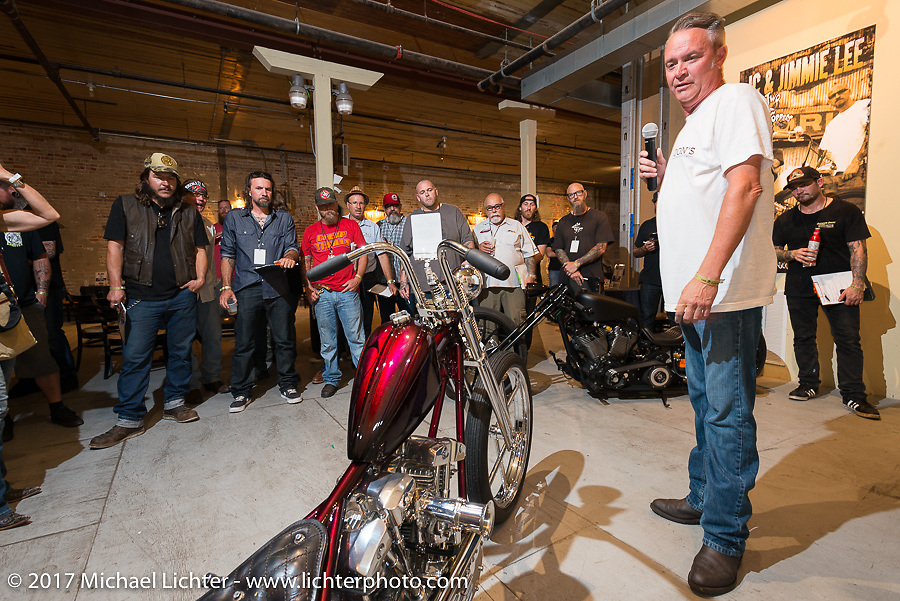 Custom builder Donny Loos of Don's Customs in the In Motion invitational bike show build to other builders and judges during the Lone Star Rally. Galveston, TX. USA. Friday November 3, 2017. Photography ©2017 Michael Lichter.