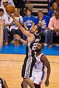 June 2, 2012; Oklahoma City, OK, USA; San Antonio Spurs guard Manu Ginobili (20) drives toward the basket during a playoff game against the Oklahoma City Thunder  at Chesapeake Energy Arena.  Thunder defeated the Spurs 109-103 Mandatory Credit: Beth Hall-US PRESSWIRE