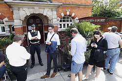 © Licensed to London News Pictures. 26/06/2017. London, UK. Visitors enter Westminster coroner's court as an inquest is held into the deaths of some of the victims of the fire at Grenfell Tower in West London. Police say 79 people are missing, feared dead after the tower block was engulfed in flames on June 14th. Photo credit: Peter Macdiarmid/LNP