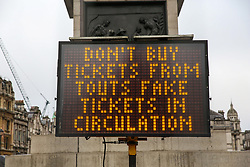 "© Licensed to London News Pictures. 30/12/2018. London, UK. A sign saying ""Don't buy tickets from touts fake tickets in circulation"" in Trafalgar Square, ahead of New Year celebrations. Photo credit: Dinendra Haria/LNP"