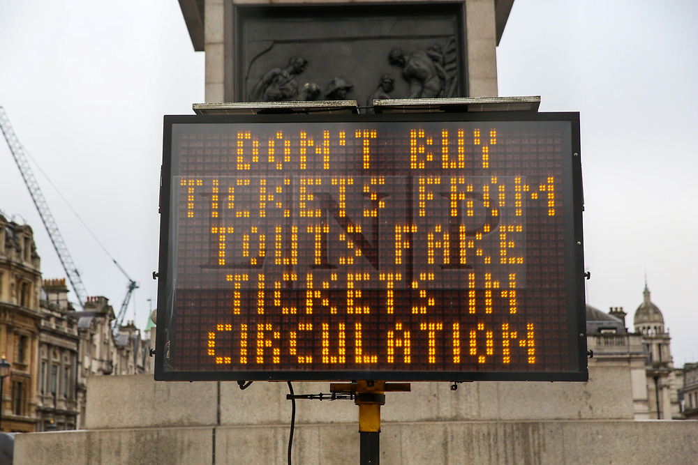 """© Licensed to London News Pictures. 30/12/2018. London, UK. A sign saying """"Don't buy tickets from touts fake tickets in circulation"""" in Trafalgar Square, ahead of New Year celebrations. Photo credit: Dinendra Haria/LNP"""