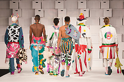 © Licensed to London News Pictures. 01/06/2014. London, England. Collection by Sarah Fisher from the Manchester School of Art. Graduate Fashion Week 2014, Runway Show at the Old Truman Brewery in London, United Kingdom. Photo credit: Bettina Strenske/LNP