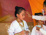 Muslim Cham girls wearing white dresses and bronze and copper jewellery at their Karoh (maturity) ceremony in Van Lam, Ninh Thuan province, Central Vietnam. Cham girls usually in groups of around 5, undergo a Karoh (maturity) ceremony, one of the most important ritual events of their lives and if it has not taken place, the girl cannot marry. The Cham, a Muslim community of around 39,000 people living along the coast of Central Vietnam are one of the 54 ethnic groups recognised by the Vietnamese government.