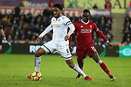 Leroy Fer of Swansea city is challenged by Sadio Mane of Liverpool (r) Premier league match, Swansea city v Liverpool at the Liberty Stadium in Swansea, South Wales on Monday 22nd January 2018. <br /> pic by  Andrew Orchard, Andrew Orchard sports photography.
