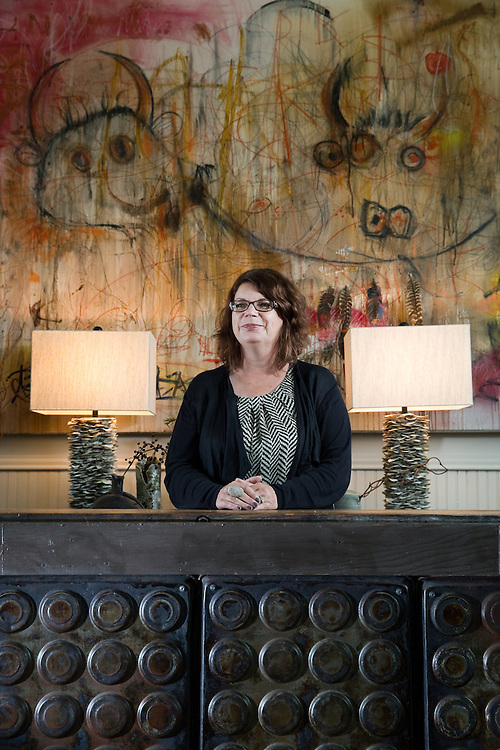 Lisa Moody poses for a portrait at her store the French Table in Mason City. Moody renovated a 1907 church to create the store specializing in urban eclectic arts, antiques and interiors. (Independent/Matt Dixon)