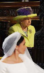 Queen Elizabeth II looks on during the wedding of Prince Harry and Meghan Markle in St George's Chapel at Windsor Castle.
