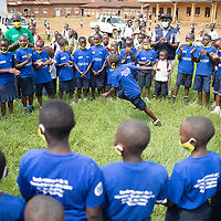 At a school in Butembo, Congo, children sing and dance. The children have been specially trained in healthcare and the prevention and control of infection. IMA and Tearfund worked together on the project in the framework of a broad programme to strengthen response and recovery to Ebola in North Kivu, Congo.