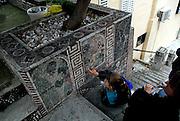 Mother and child (5 years old) admiring mosaics by artist Miro Luketina, Makarska, Croatia.