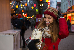 Portrait of young woman with Christmas gift