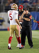 San Francisco 49ers head coach Chip Kelly talks to San Francisco 49ers quarterback Christian Ponder (5) during a timeout during the 2016 NFL preseason football game against the San Diego Chargers on Thursday, Sept. 1, 2016 in San Diego. The 49ers won the game 31-21. (©Paul Anthony Spinelli)