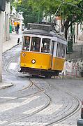 Old tram. Tram tracks. At Miradouro de Santa Luzia. Street view. Alfama district. Lisbon, Portugal