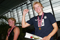 Svømming - NM i langbane Piranlegget Trondheim 6. juli 2002. Ann Kristin Aamodt fra Tromsø vant overraskende 50 meter rygg for damer foran en Iwonka Vik (til venstre). Bergenssvømmeren deppet for sølv. <br /> <br /> Foto: Andreas Fadum, Digitalsport