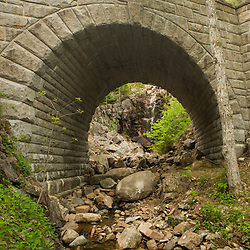 A waterfall framed by an archway in Waterfall Bridge.  Part of the carriage road system in Maine's Acadia National Park.