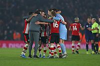 Football - 2019 / 2020 Premier League - Southampton vs. Tottenham Hotspur<br /> <br /> Southampton Manager Ralph Hasenhuttl gives an impromptu group hug after a home win at St Mary's Stadium Southampton<br /> <br /> COLORSPORT/SHAUN BOGGUST