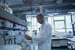 Male scientist working in a pharmacy laboratory, Freiburg im Breisgau, Baden-Wuerttemberg, Germany