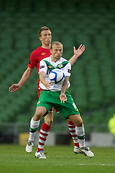 DUBLIN, REPUBLIC OF IRELAND - Friday, May 27, 2011: Wales' Danny Collins and Northern Ireland's Warren Feeney during the Carling Nations Cup match at the Aviva Stadium (Lansdowne Road). (Photo by David Rawcliffe/Propaganda)
