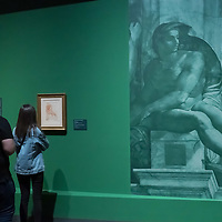 Visitors view artworks on display created by Michelangelo Buonarroti at an exhibition in the Museum of Fine Arts in Budapest, Hungary on April 9, 2019. ATTILA VOLGYI