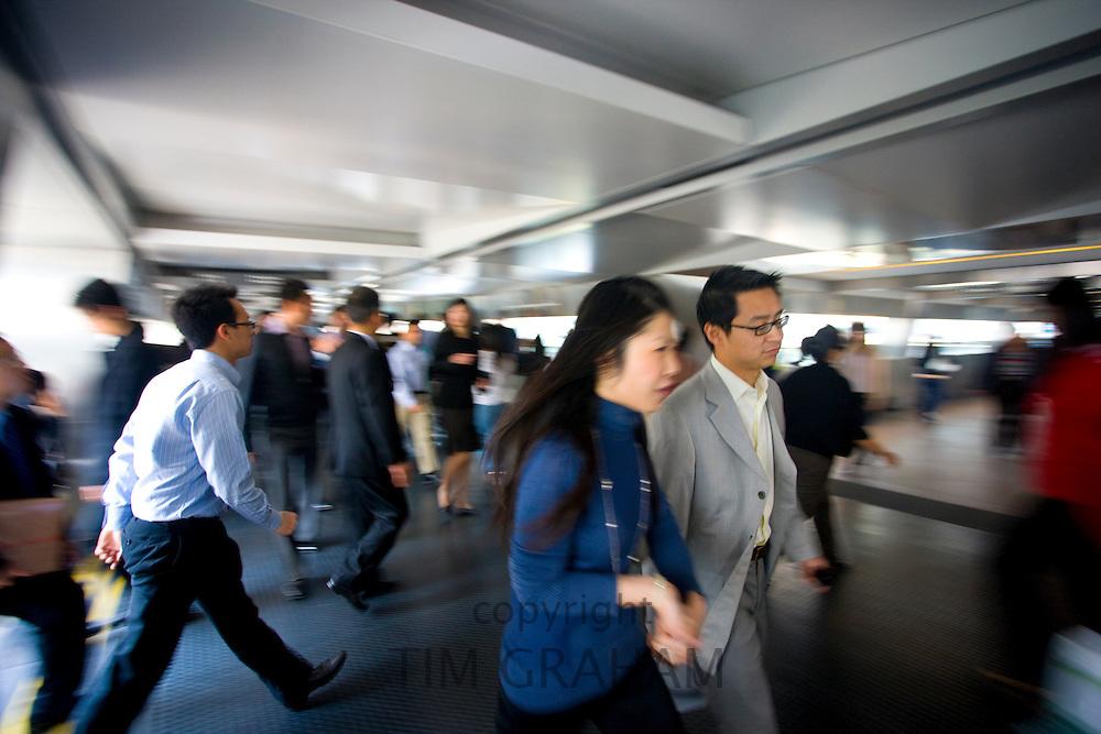 Busy elevated walkways in Hong Kong Financial District, Connaught Road, Central Hong Kong Island, China