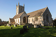Graves in the graveyard of the village parish church of Saint James the Greater, Dauntsey, Wiltshire, England, UK