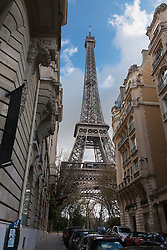 Low angle view of Eiffel Tower against cloudy sky, Paris, France