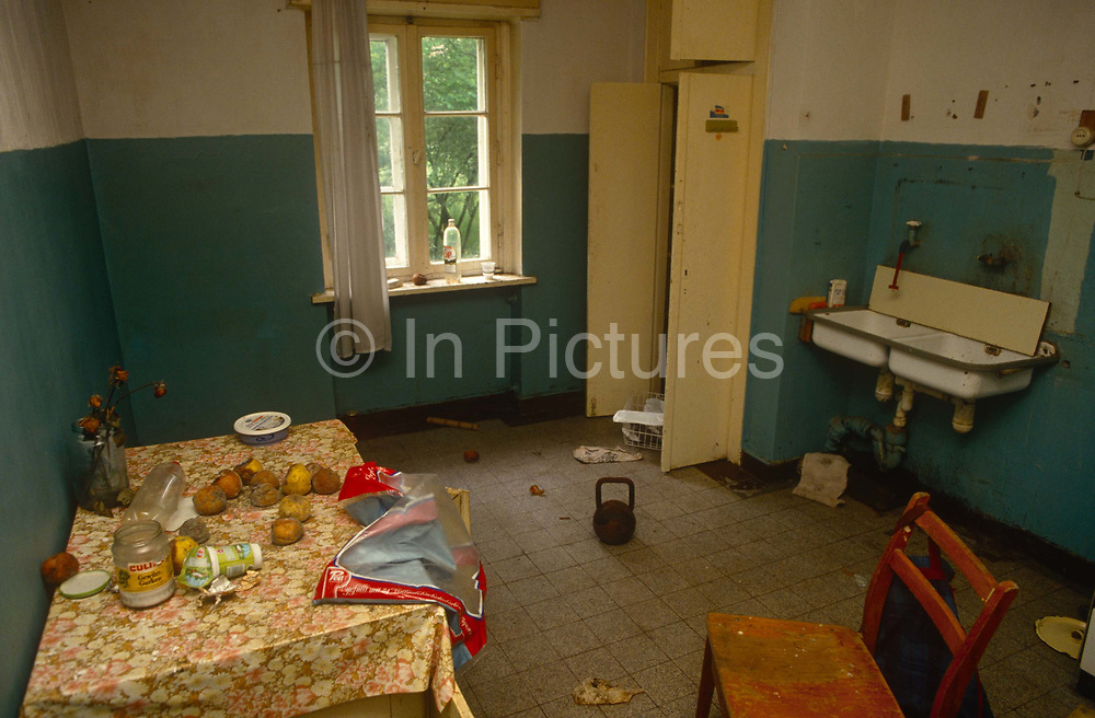 The kitchen of an abandoned in the former Russian Soviet army camp in occupied East Germany ex-GDR/DDR, on 16th June 19990, on Halb Insel Wustrow, near Rostock, Germany. The occupants appear to have left in a hurry - or were careless enough to leave possessions and fresh fruit, now rotting on the kitchen table.